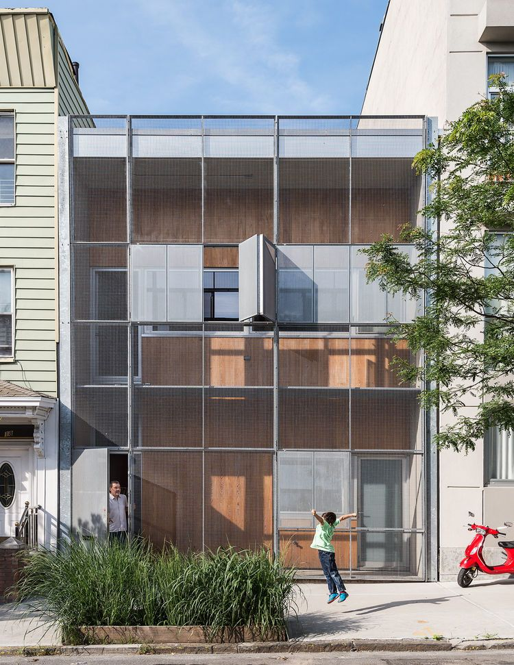 The Baumann family residence in Gowanus, Brooklyn, is all geometry up  front, with a rectilinear grid of steel and cypress comprising the  structure's double ...