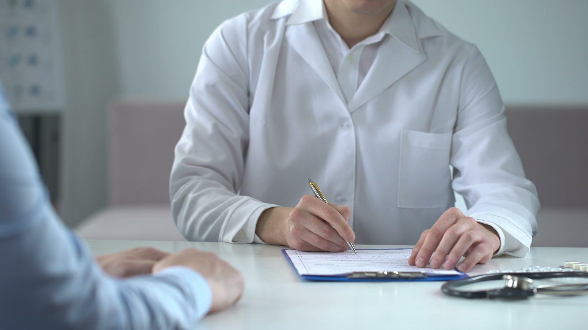 Doctor writing fake medical examination taking bribe expensive