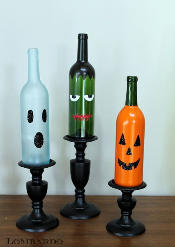 DIY Halloween Wine Bottles - Adorable looking Halloween bottles that you can put on display on your shelves or coffee table. These are fairly simple DIY crafts and can be done in a short span of time.