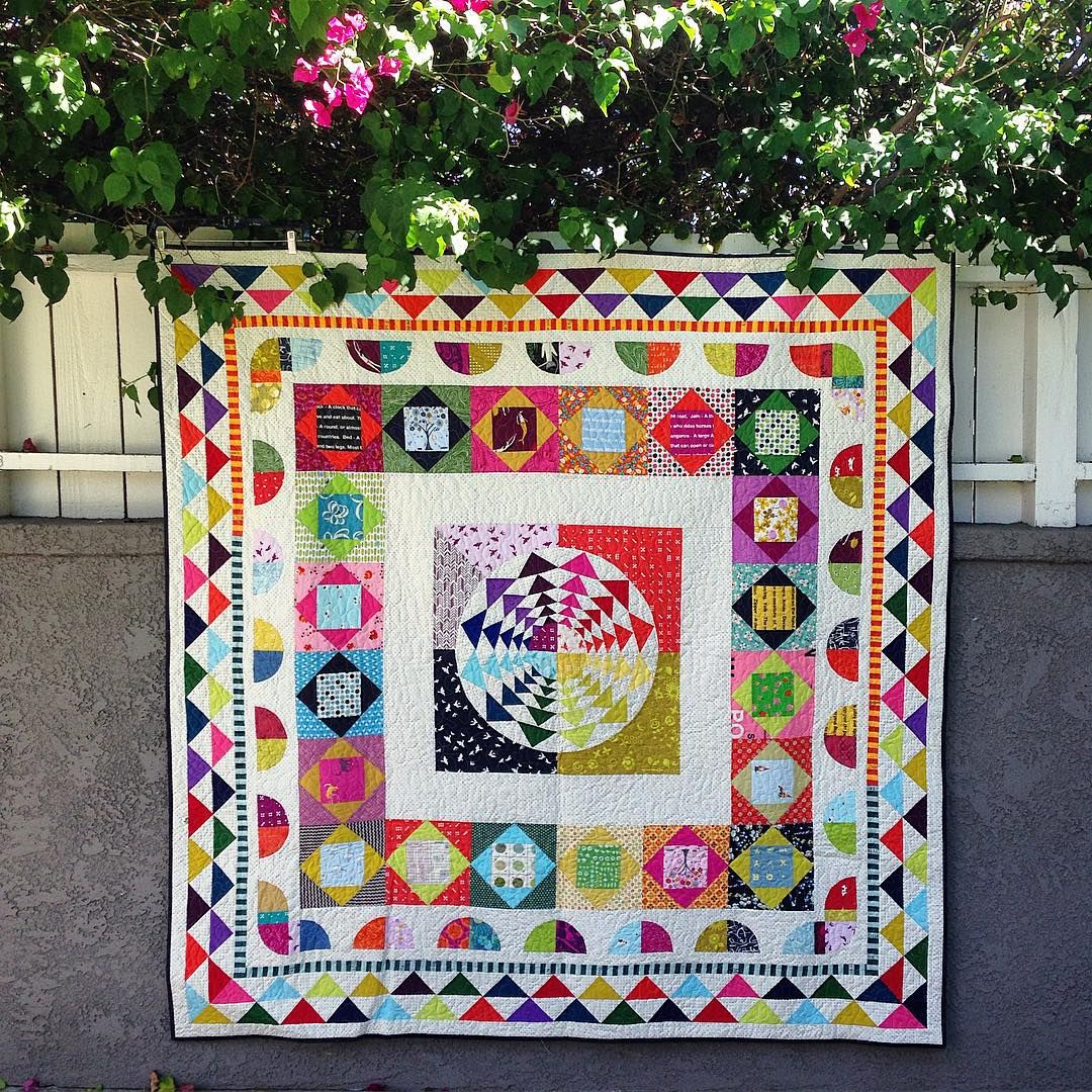 I don't think I ever posted a proper photo of this quilt. The center is my Right Round pattern and I made the rest of the borders up as I went along: Economy Blocks, Drunkard's Paths and HSTs. #rightroundquilt
