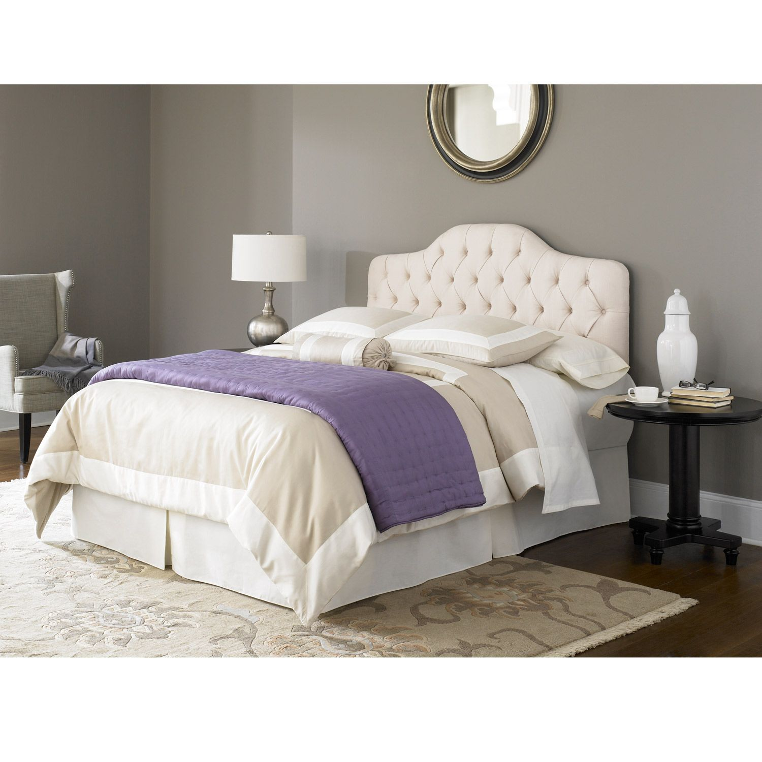 add a classic touch to your bedroom with this ivory upholstered