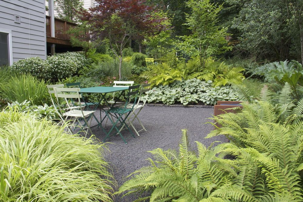 After Subtle Terracing Made Room For Two Outdoor Living Spaces While Textural Plantings Give The Garden D Garden Landscape Design Garden Design Mosaic Garden