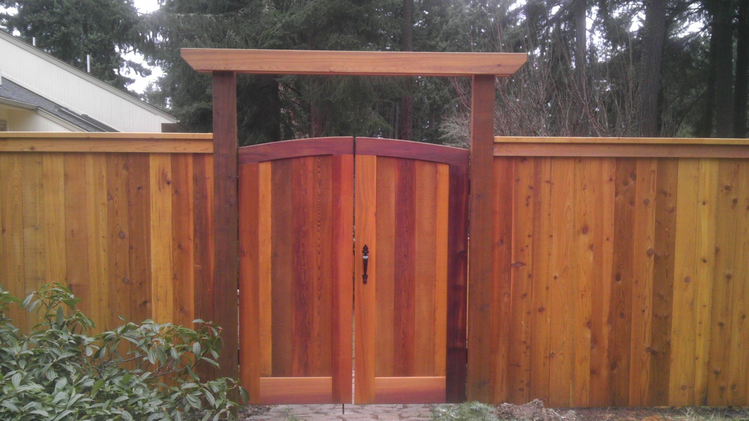 Cap and bevel fencing with custom double gates Beautiful western