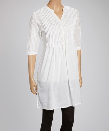 Oh, how I love this! The accessories that I could use to dress this up are endless!!! So many different looks could start with this one tunic!  LOVE! Oh, and it looks long enough that in the summer it can be worn as a dress. :) Loving this White Pearl Tunic on #zulily! #zulilyfinds