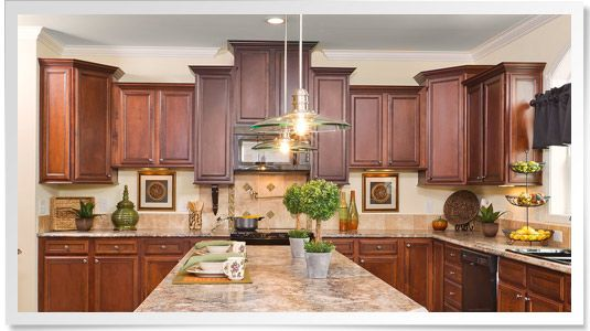 Lovely Staggered Overhead Cabinets Are An Easy Way To Add Some Drama And Elegance  To Any Kitchen