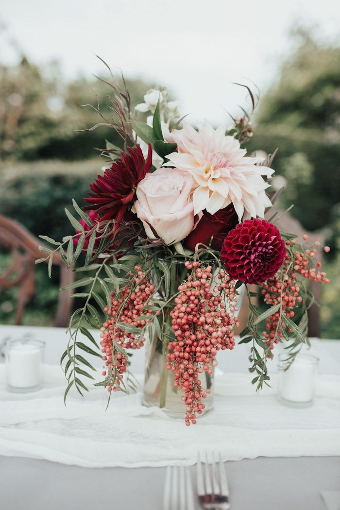 Amazing and vibrant floral design from this vintage-inspired wedding reception | Image by Elizabeth Anne Studios