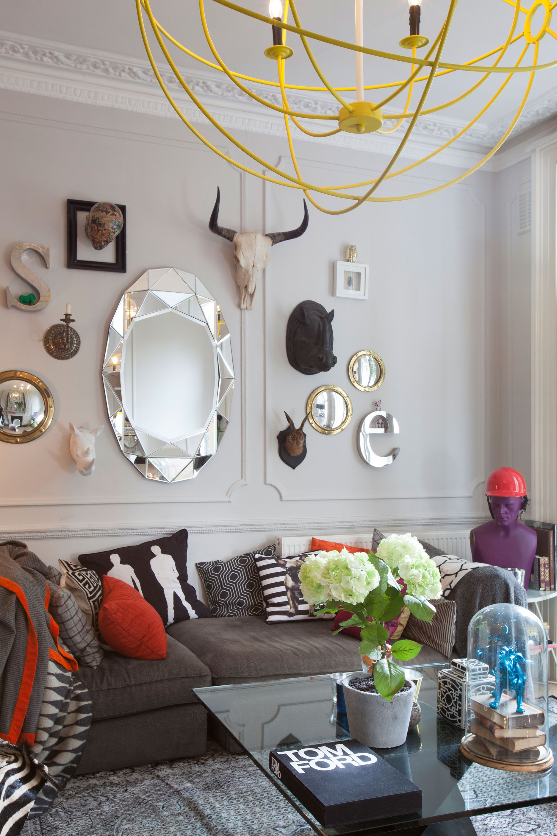 Eclectic sitting room with neon yellow chandelier
