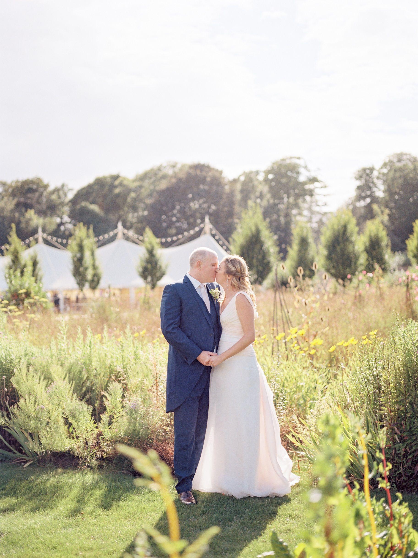 White marquee wedding in a walled garden Marquee wedding