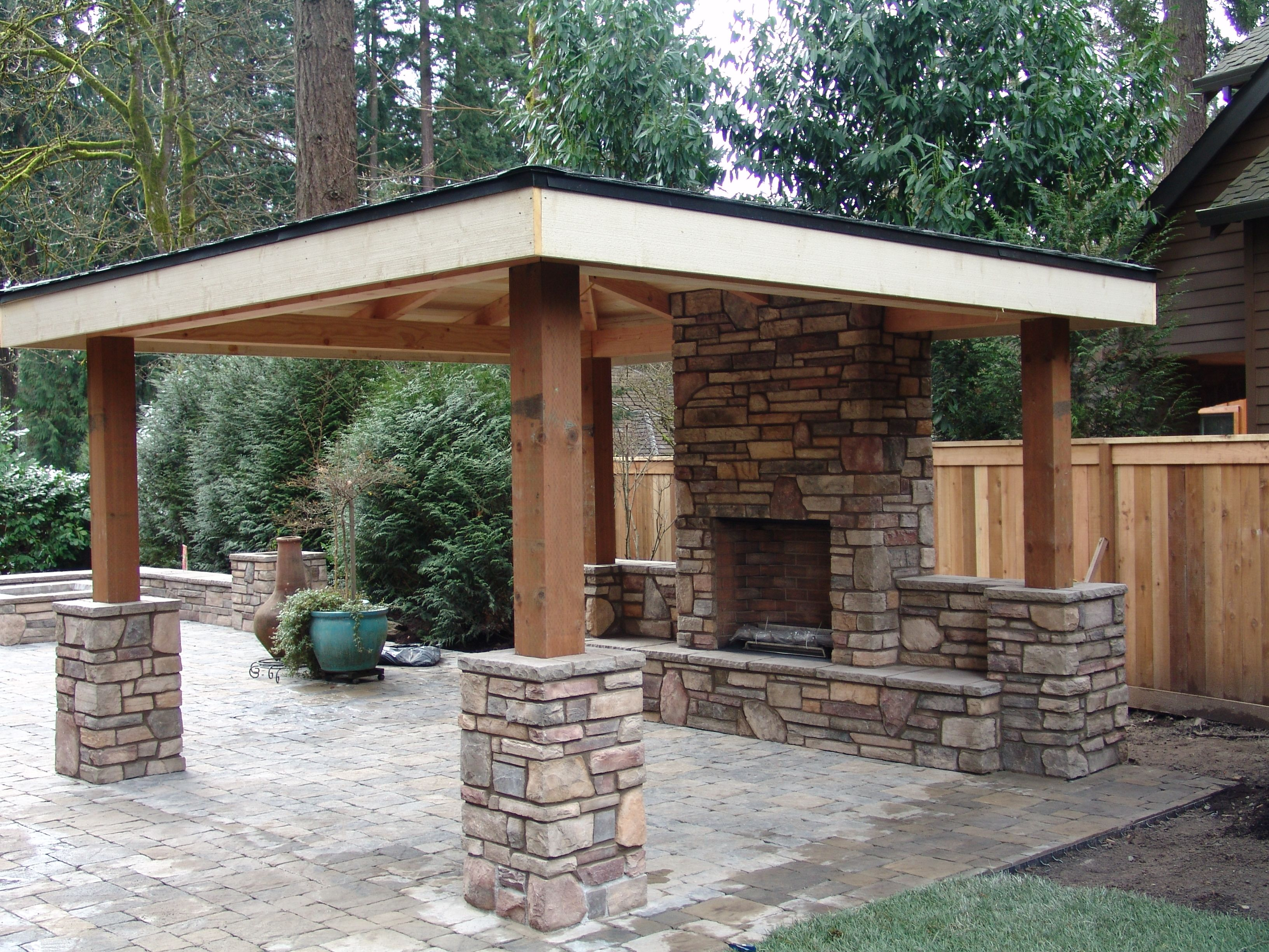 outdoor kitchen with fireplace greenhouse windows for covered fire pit living