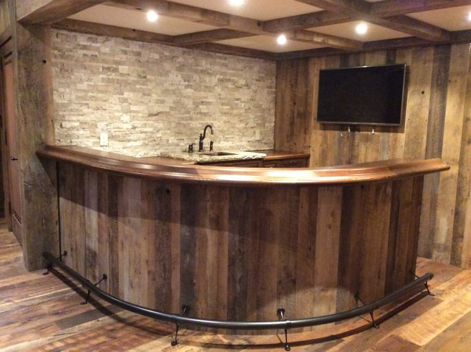 oak curved home bar with curved footrail and granite server tops