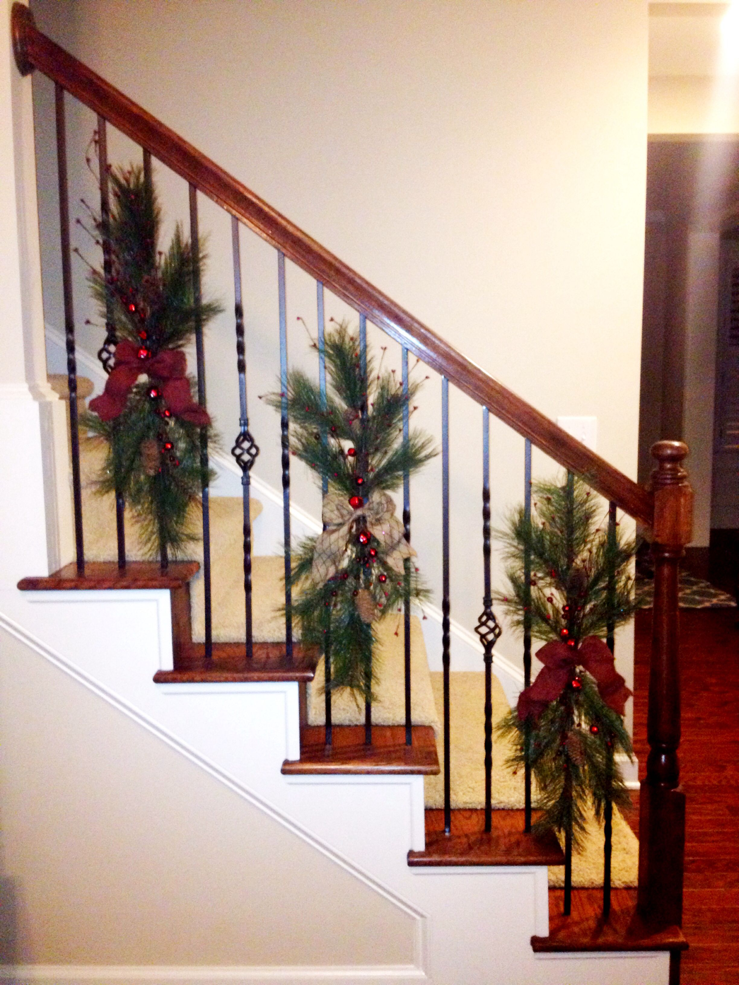 Christmas Swags Tied To Stair Railing Instead Of Wrapping Garland Around The Baniste Christmas Stairs Decorations Christmas Staircase Decor Christmas Staircase