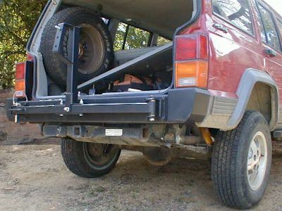 Bumper Mounted Tire Carrier Swings Out Away From The Hatch