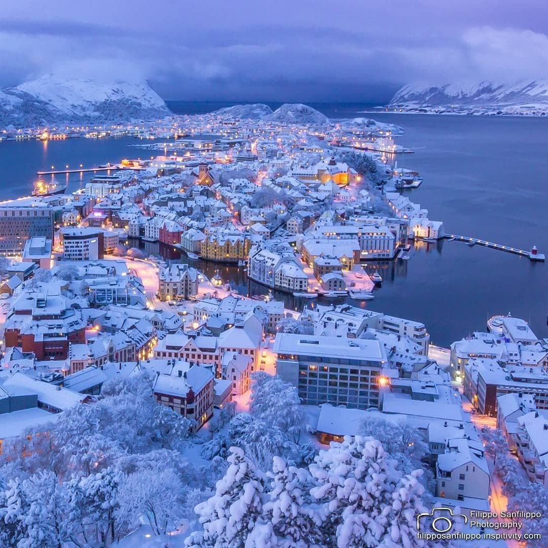 Charming Norwegian town in the snow - Ålesund Norway   Cool places to  visit, Beautiful places to travel, Alesund