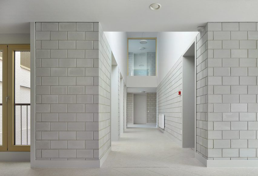 Drdh And Advvt Complete Elderly Home In Belgium Featuring Pared Back Finishes And Open Air Courtyards Concrete Interiors Concrete Block Walls Brick Interior