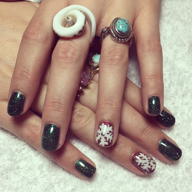Holiday nail art, Gel manicure with green gel polish, snowflakes and ...