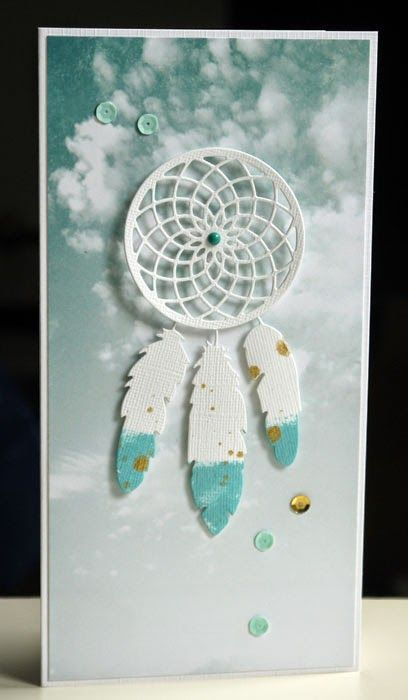 handmade card ... dreamcatcher of die cut doily and three feathers  ... monochromatic aqua ... tall and narrow (#10) ... luv the printed paper with a cloudy sky ... great card!