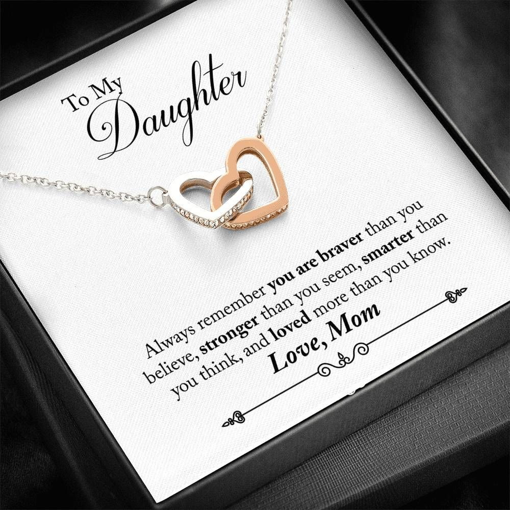 """""""To My Daughter, Always remember that you are braver than you believe, stronger than you seem, smarter than you think, and loved more than you know. Love, Mom"""" ✅ Handmade and Shipped from the USA✅ 14K White Gold and Rose Gold Plated✅ Free Gift Box and Message Card Included✅ Free USA Shipping✅ Quality Guaranteed! You can't put a price on the love between a mother and daughter. This beautiful interlocked hearts necklace and message card are sure to always remind your daughter of how much she is tr"""