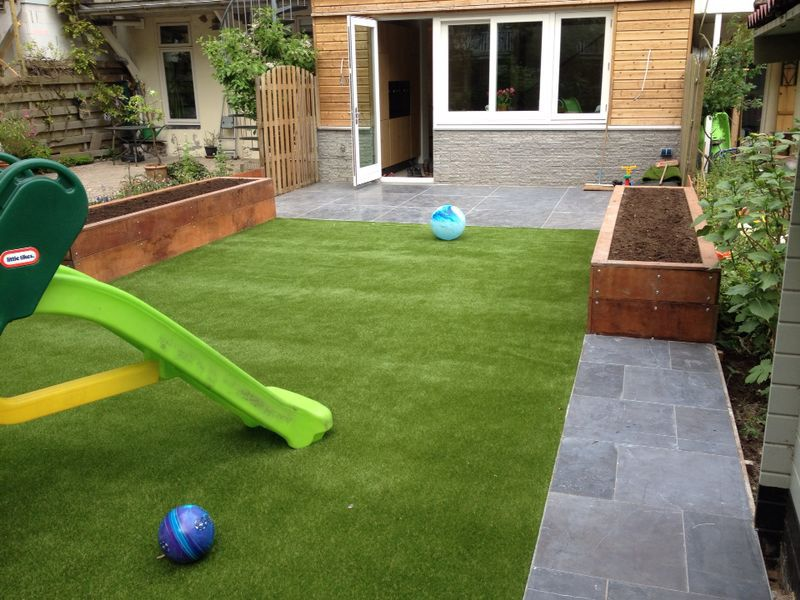 Patio And Artificial Grass Lawn.