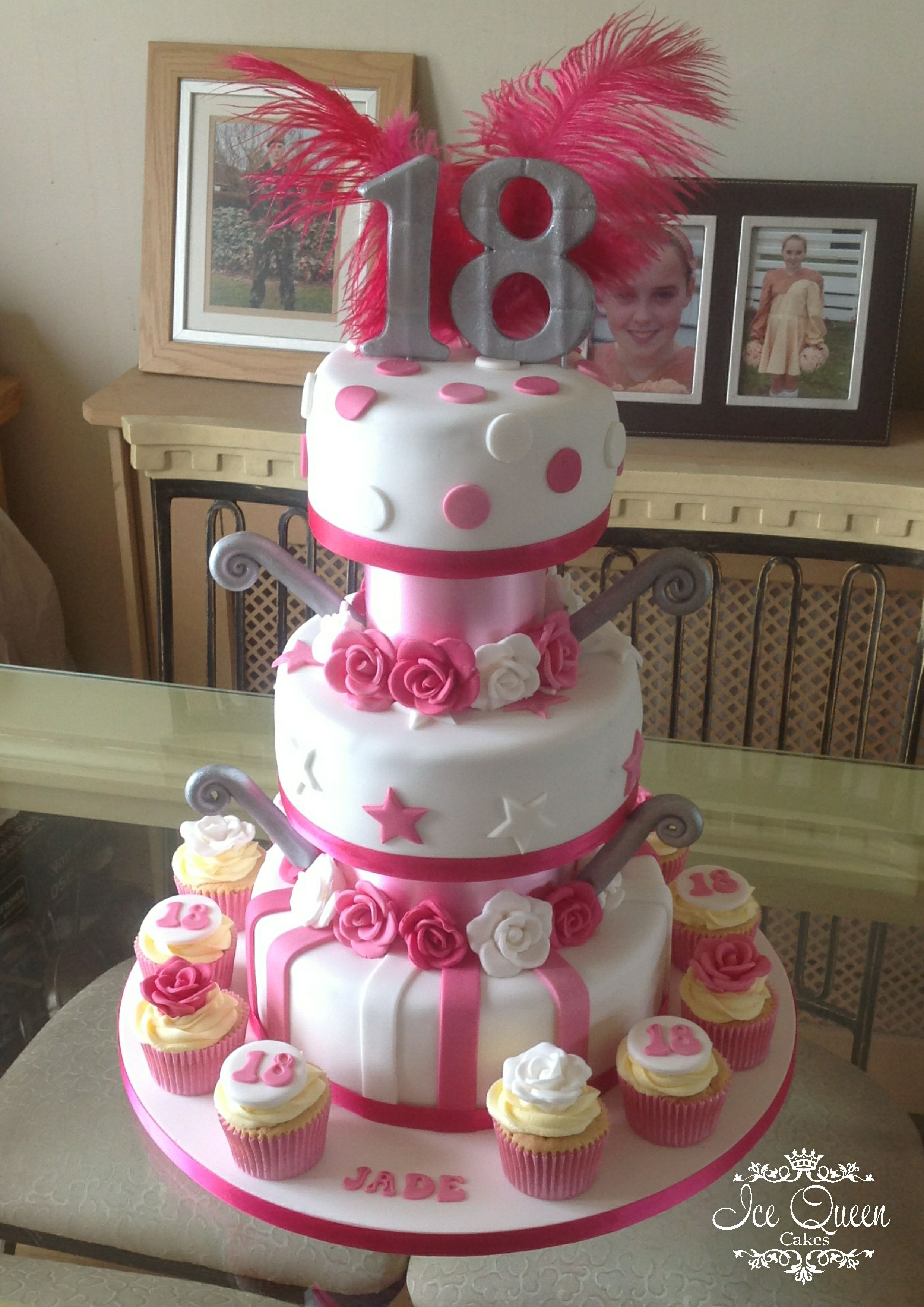 3 tier 18th birthday cake in pink white silver with cupcakes