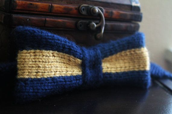 Hand knit Ravenclaw-style bow tie, using book colors with a sing horizontal stripe of bronze.
