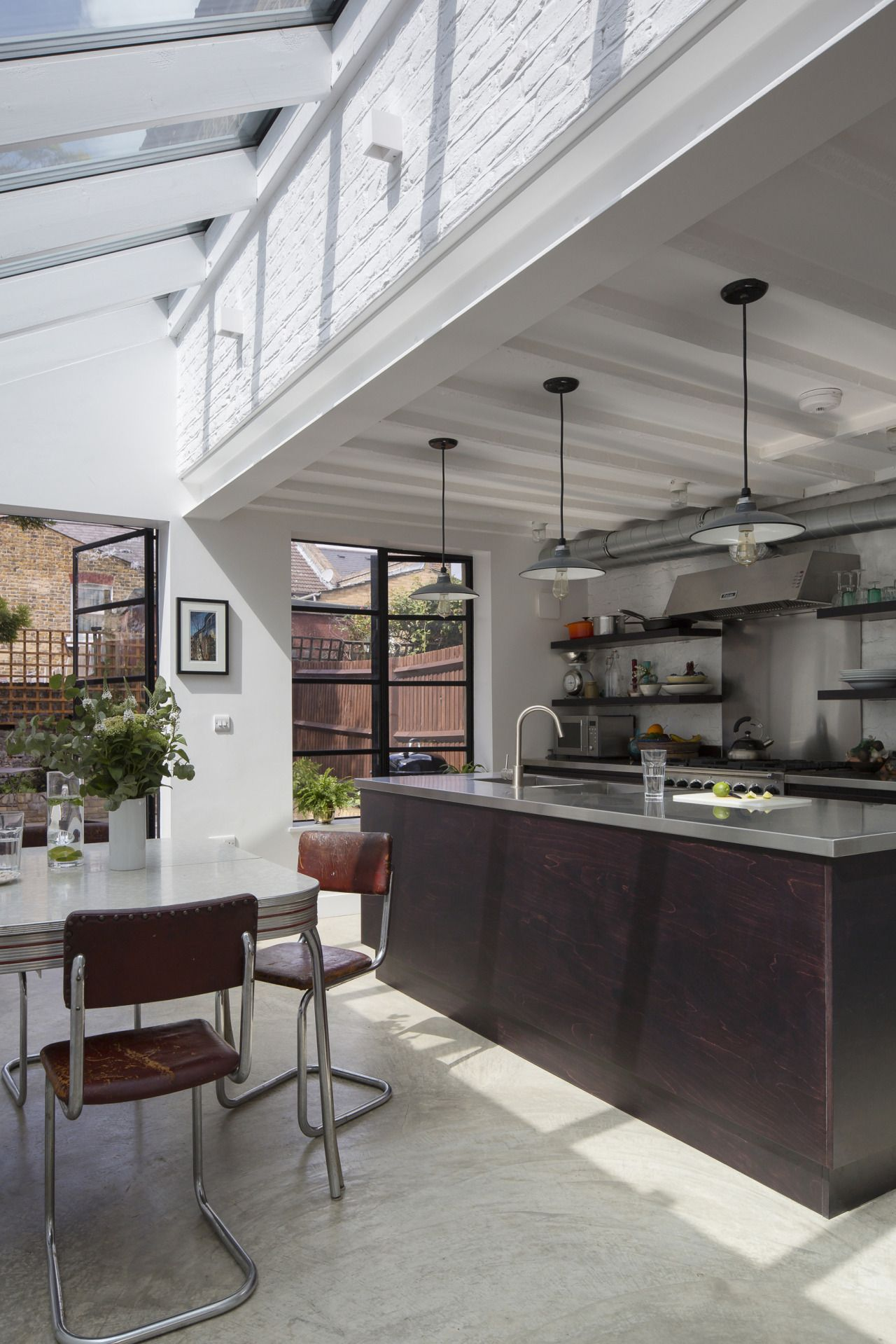 steel crittal windows and a high glass side return combine to make