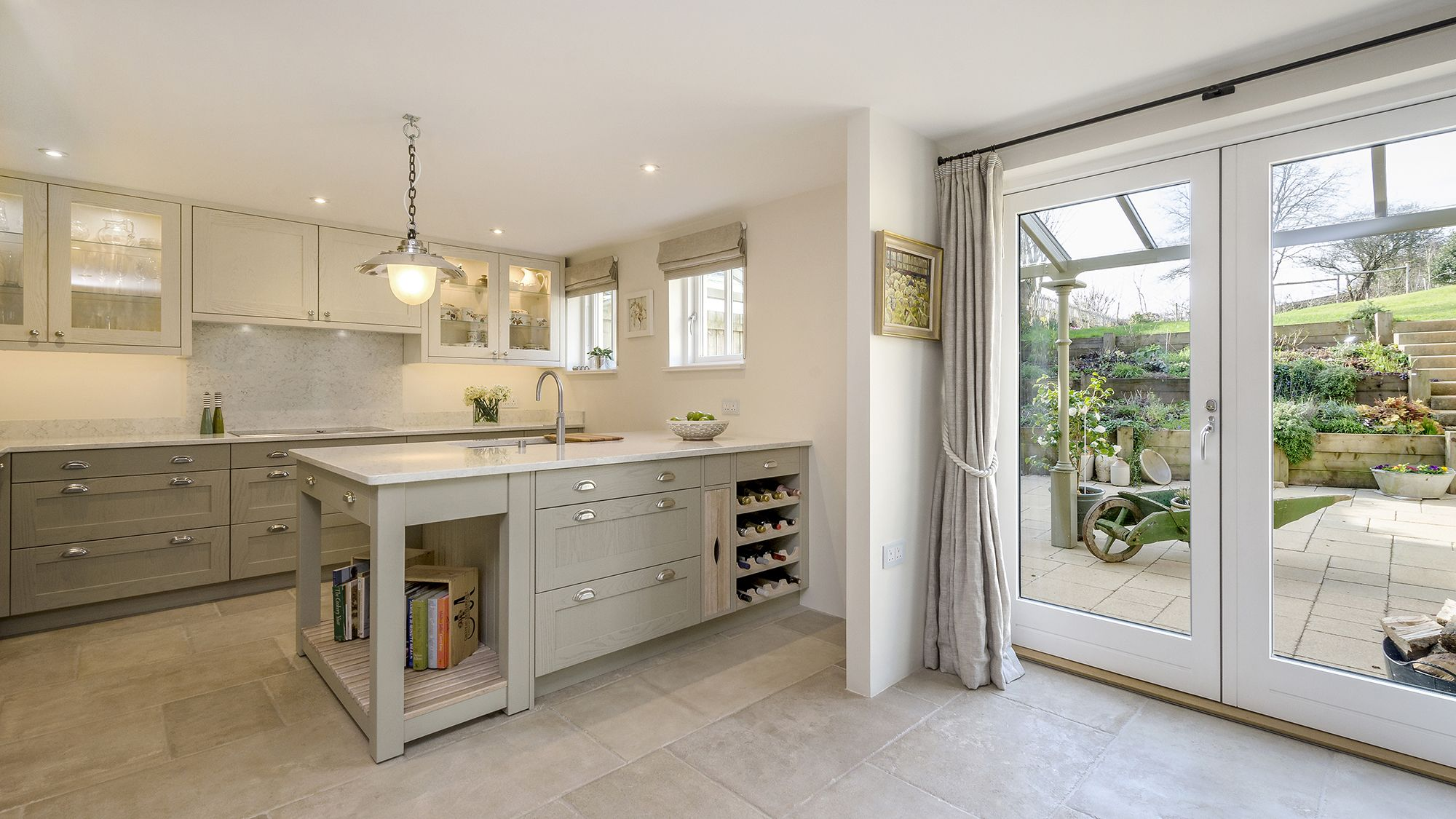 solid painted ash kitchen with silestone 'blanco orion' worktops