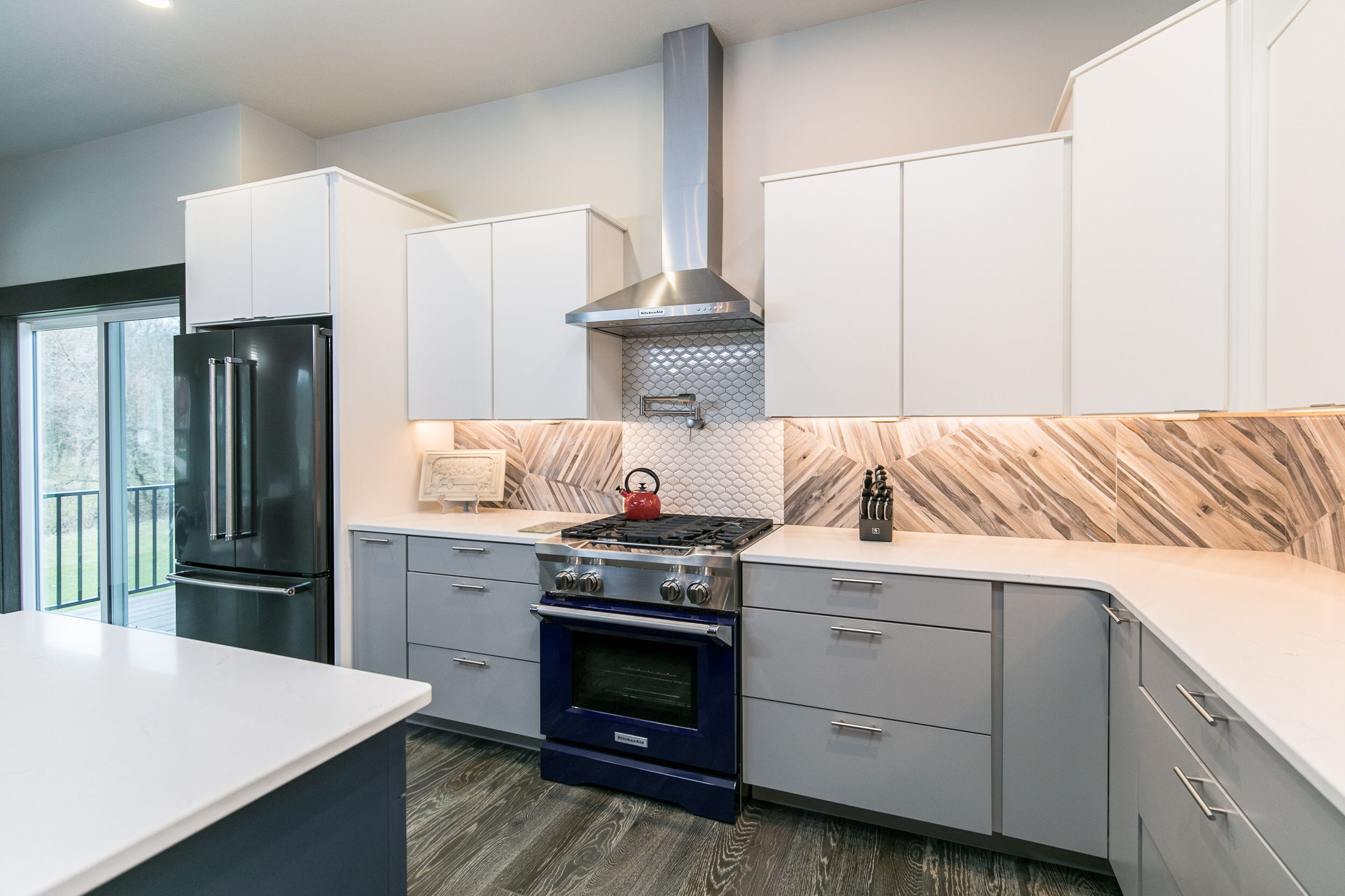 Add glossy cabinets, chrome finishes, and designed tiles ...