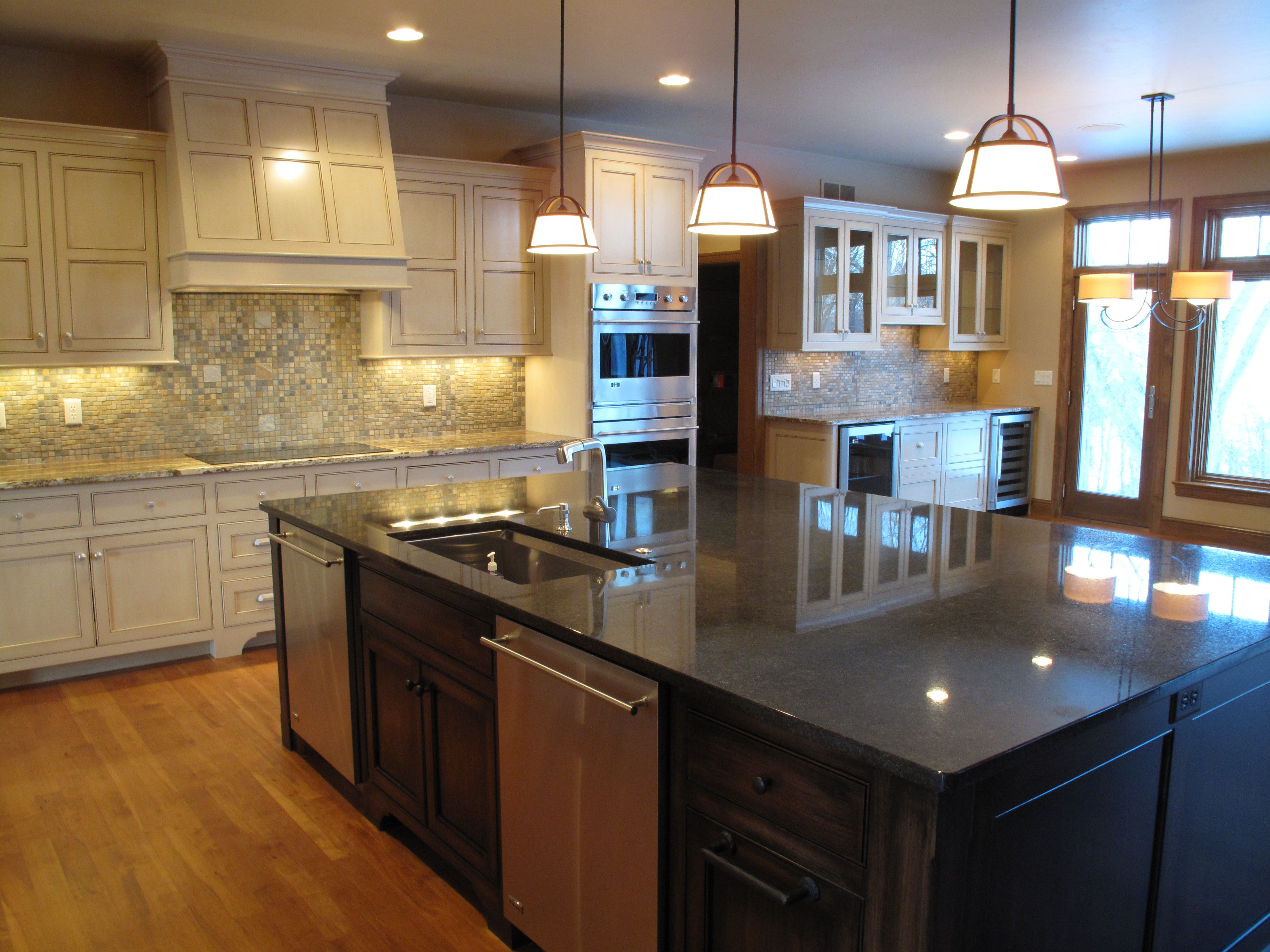 Extra large island in this beautiful kitchen design