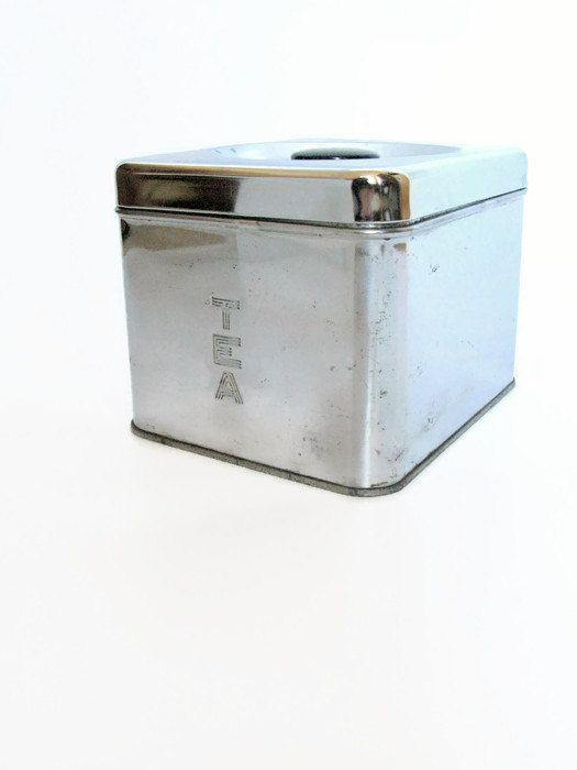 Lincoln Beautyware Square Chrome Tea Canister  The canister measures 5 x 4 1/2 x 6, and is marked Lincoln Beauty Ware on the base.  The canister is in