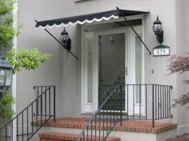 Black Canvas Awning With White Trim Outdoor Landscapingfront Door