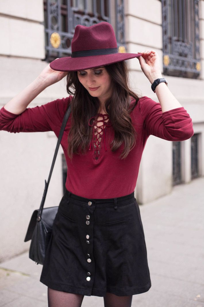 outfit burgundy hat, lace up top, button down skirt