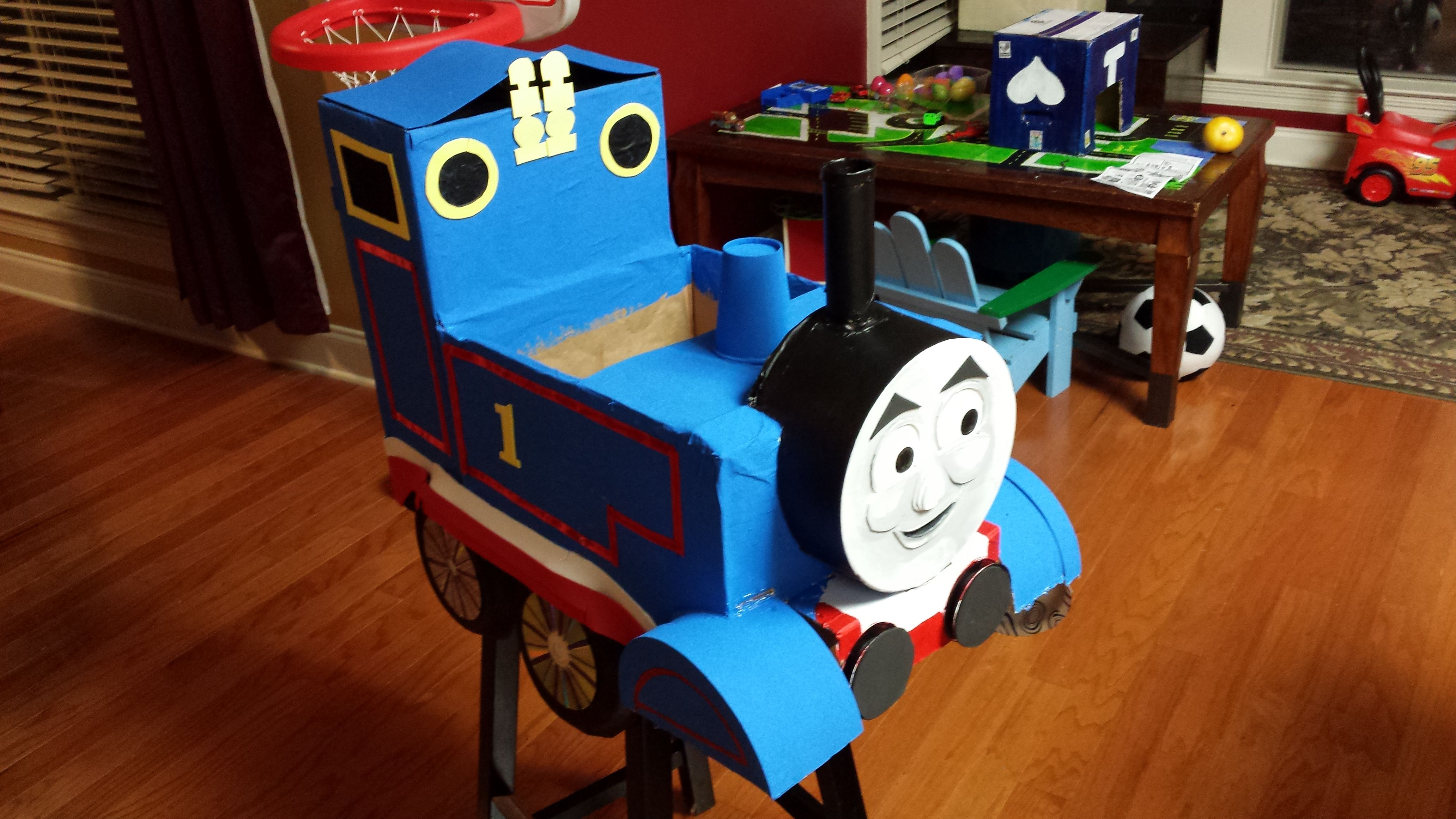 Thomas the Train costume out of old boxes a paper-mache hat box set ($8 from Michaelu0027s) paper plates old CDu0027s foam for facial features whistles etc. ... & Thomas the Train costume out of old boxes a paper-mache hat box set ...