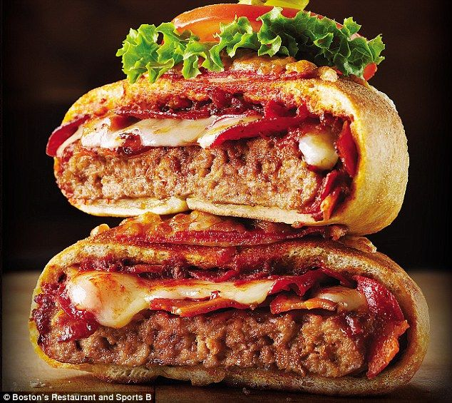 Meet the Pizza Burger: A bacon cheeseburger wrapped in a pepperoni pizza & cooked like a calzone...created by Boston's Restaurant & Sports Bar. (1,360 calories and 2,000 milligrams of sodium!)