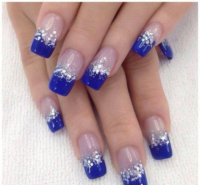 Beautiful dark blue nail art design in French tips. The French tip designs  are n blue nail polish and are bordered with silver glitter and sequins as  they ... - Ice Blue Nail Art Pinterest Prom Nails, Manicure And Pretty