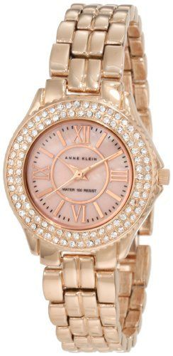 Anne Klein Women's 10/9536RMRG Swarovski Crystal Accented Rose-Gold Tone Bracelet Watch Anne Klein. $85.00. Round case finished in polished rosegold-tone and set with 94 clear genuine swarovski crystals in bezel. Rosegold-tone colored genuine mother-of-pearl dial with roman numeral xii, iii, vi & ix rosegold-tone markers. Water resistant up to 100 ft. Rosegold-tone adjustable link bracelet with jewelry clasp closure. Rosegold-tone hour, minute and second hands