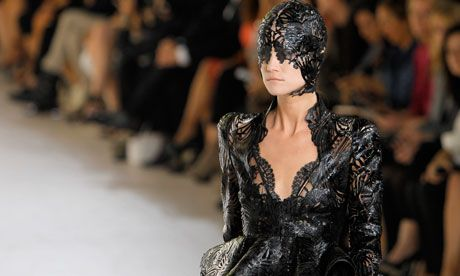 Alexander McQueen creative director Sarah Burton's lacy image of excess at Paris fashion week. Very Catwoman, and we like it Photograph: Jac...