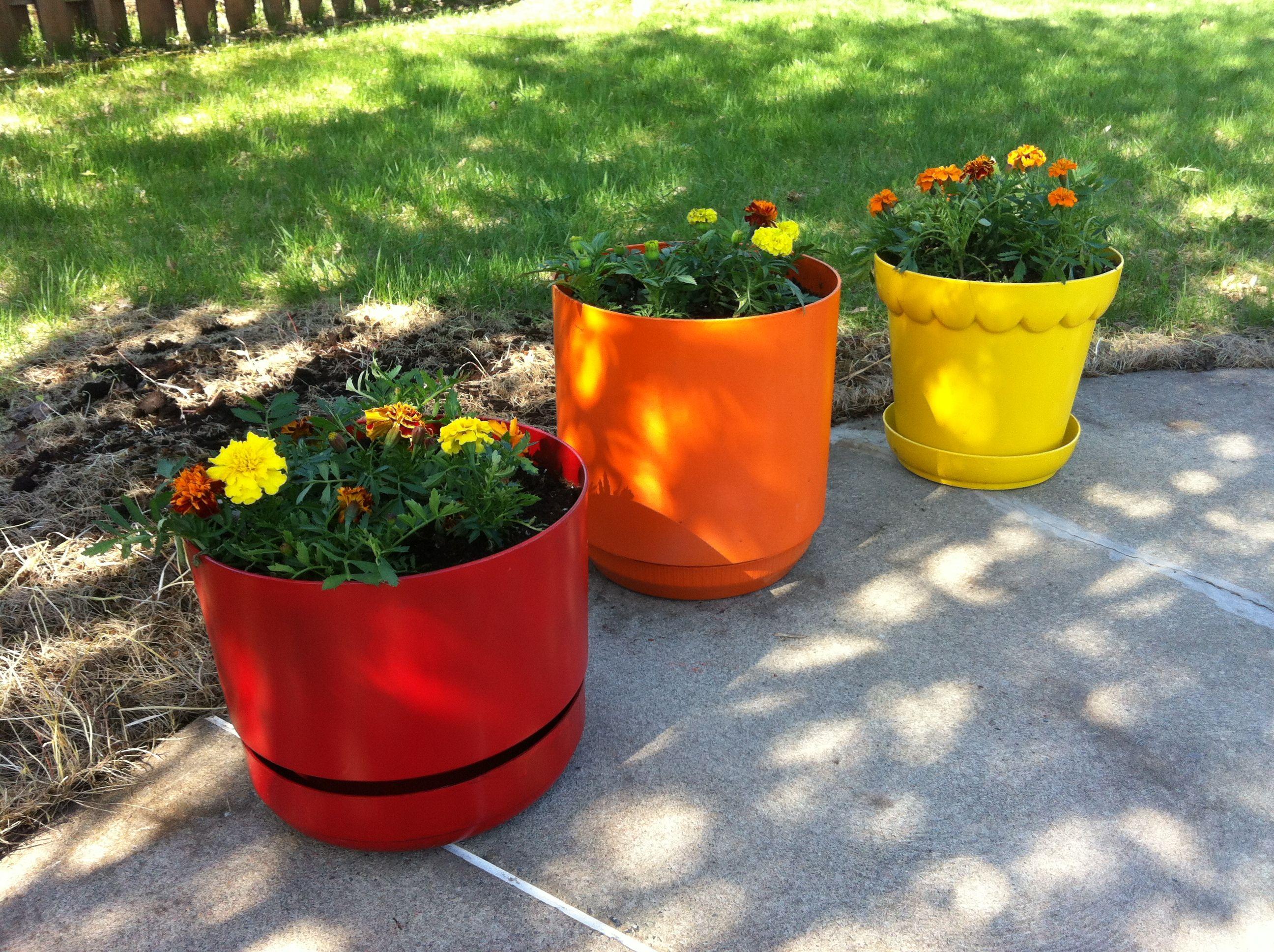 spray painted plastic flower pots.   garden/patio/outdoors