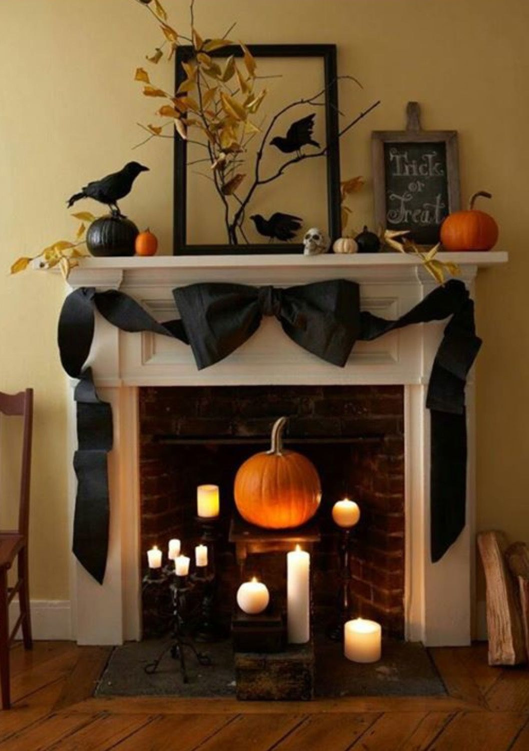 Love the different levels of candles and the pumpkin in the - Diy Indoor Halloween Decorations