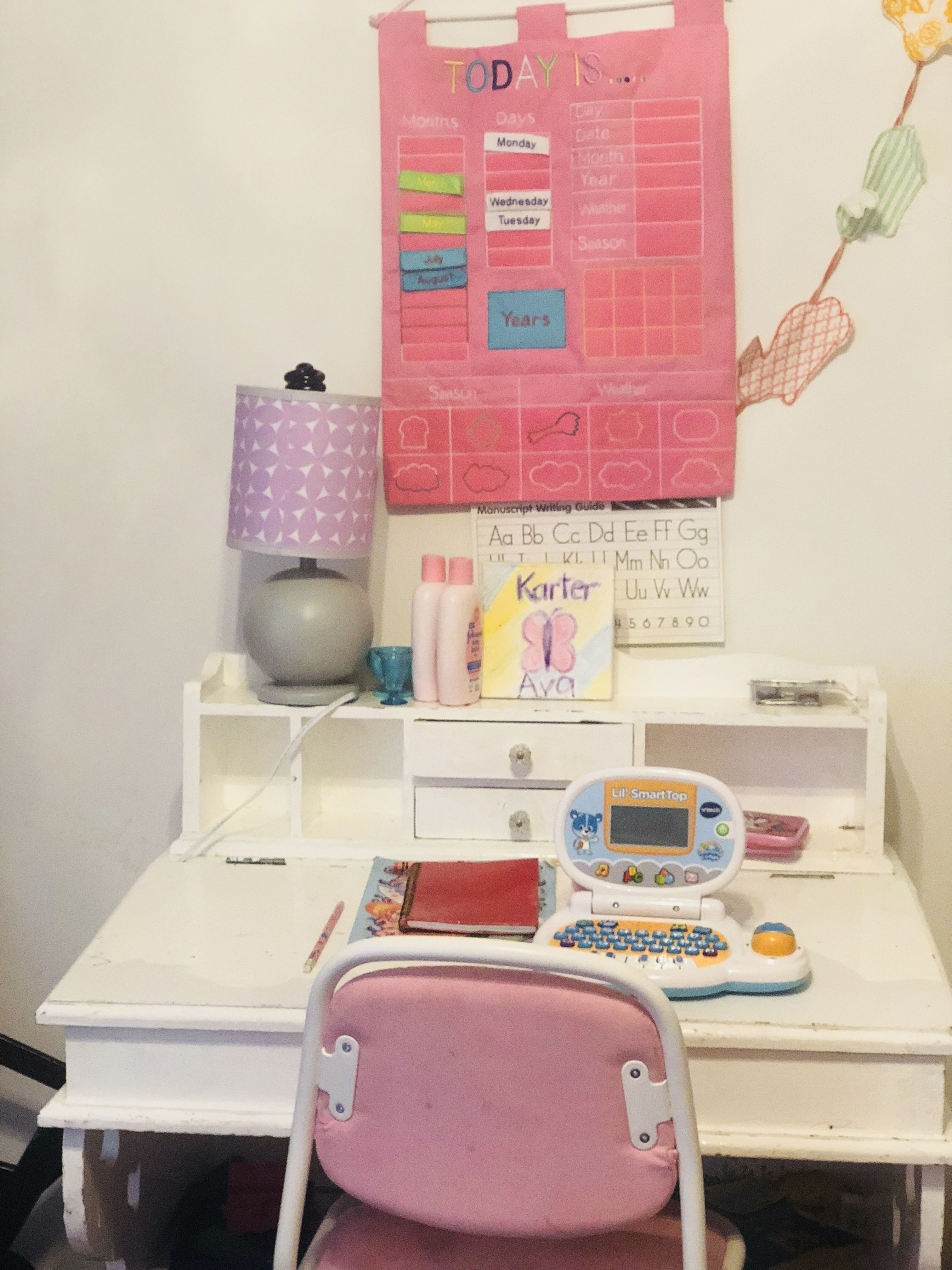 Childrens study desk featuring ikea chair and calendar