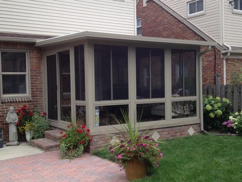3 Season Sunroom With Glass Windows And Glass Knee Wall Below Windows.  Insulated Roof System