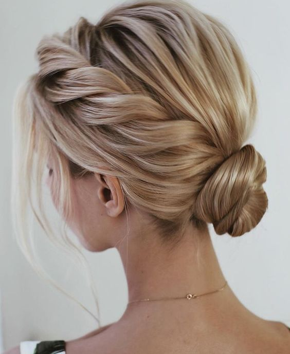 100+ Elegant wedding ideas to wow your guests---updo hairstyls with low bun chignon and side braid #lowsidebuns