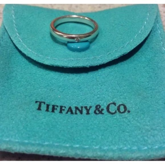 Tiffany & Co Sterling Silver Band Diamond Ring  6 Authentic Tiffany & Co Band ring with a diamond in sterling silver. Designed for stacking, elegant on its own.  Size 6 very good condition and I just had it professionally cleaned.  This is my personal ring and I have been the only owner. Tiffany bag and box not included.  Shows signs of normal wear but no significant damageListing is for 1 band with diamond. I have 2 available and they look great together. see my listing for the matching…