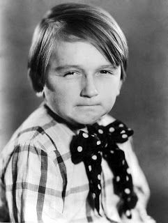 "Kendall McComas ~ (10-29-1916 - 10-15-1981) ~ first appeared in the Mickey McGuire series as a member of Mickey McGuire's gang and stayed throughout the series run in the silent era. He also played the role of Stinky Davis in some of the series' earliest sound shorts. In 1931, he joined the Our Gang  series as ""Breezy Brisbane"" in the 1932 Our Gang short Readin' & Writin'. McComas stayed with Our Gang for a full yr. & left the series after appearing in the 1932 Our Gang short Birthday Blues."