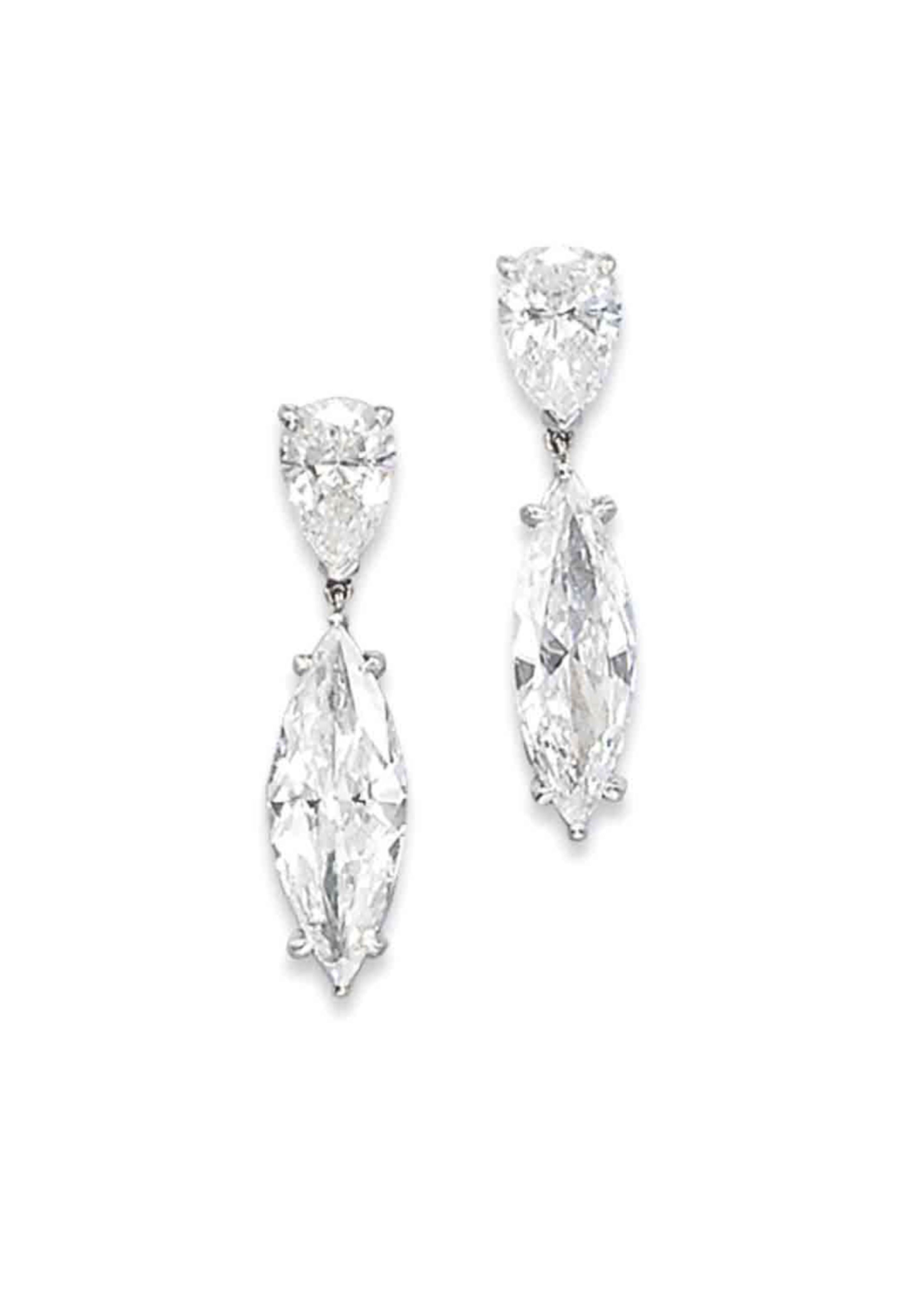 A Pair Of Diamond Earrings The Two Marquise Cut Pendants Weighing 2 46 And 01 Carats Suspended From Pear Shaped Tops