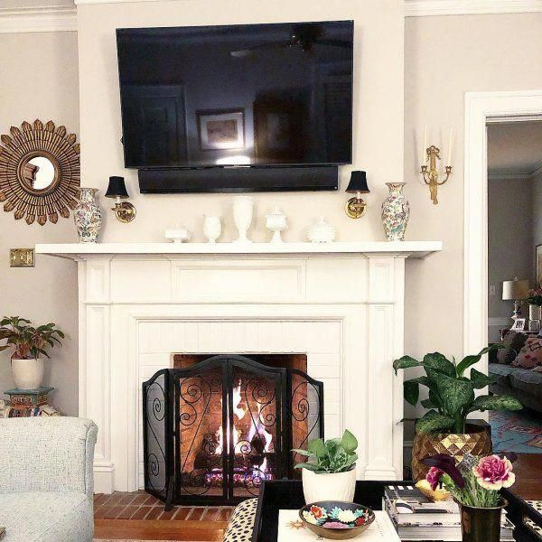 LOVE the mirrors and the shelf over the TV! | Farm house ...