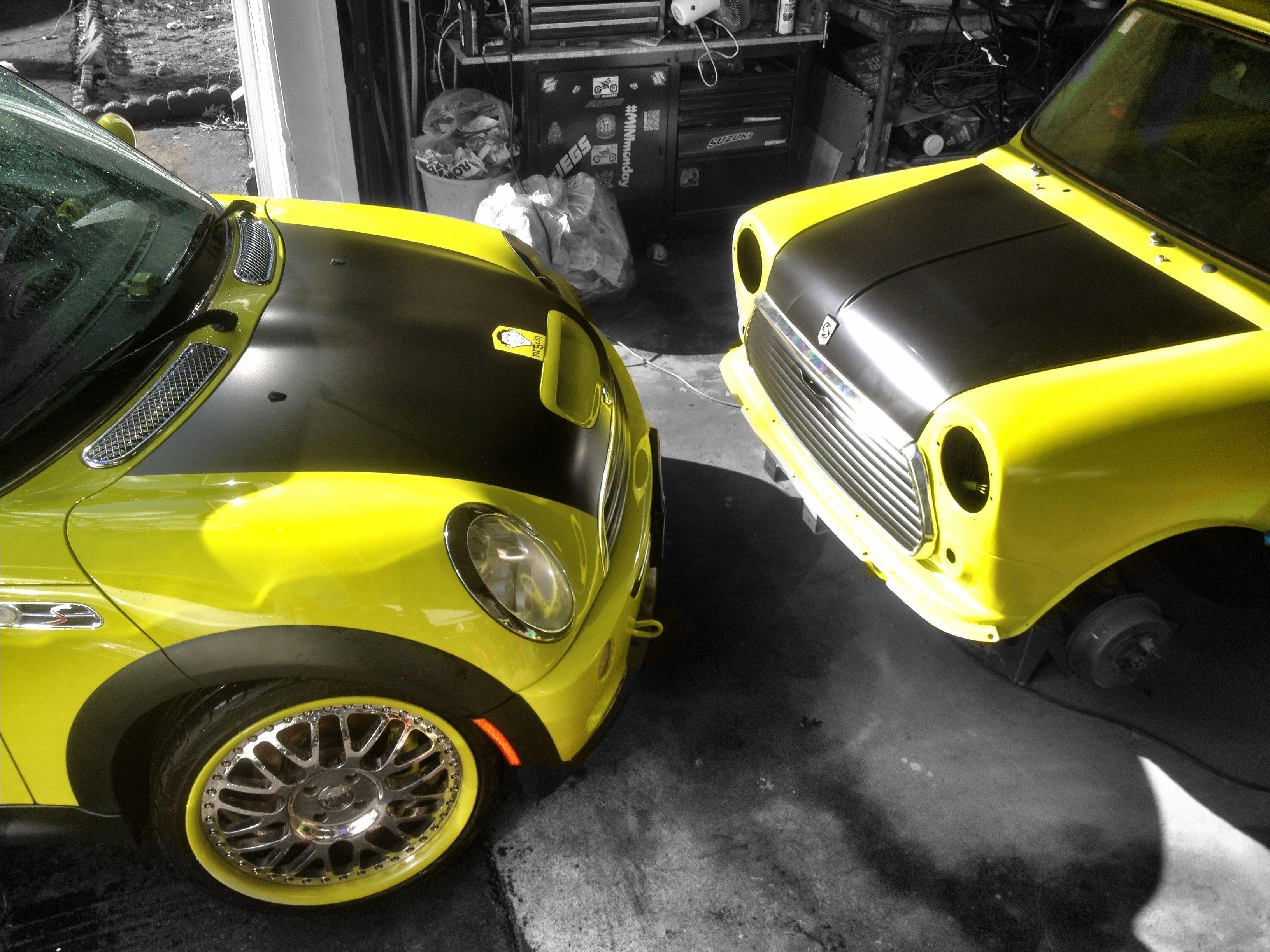The new Mr. Beanmobile Mini Cooper checking up on the progress of the Classic Mr. Bean replica.