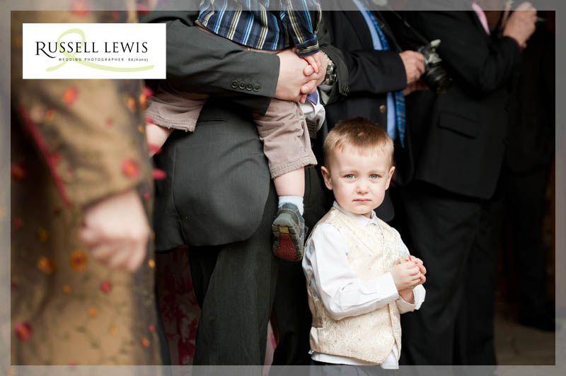 Little boy waits to throw confetti at Gorsley Chapel near Ross on Wye