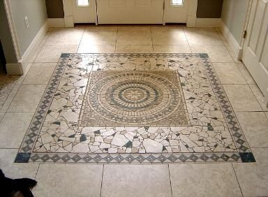 mosaic tile as transition - good way to use broken pieces ...