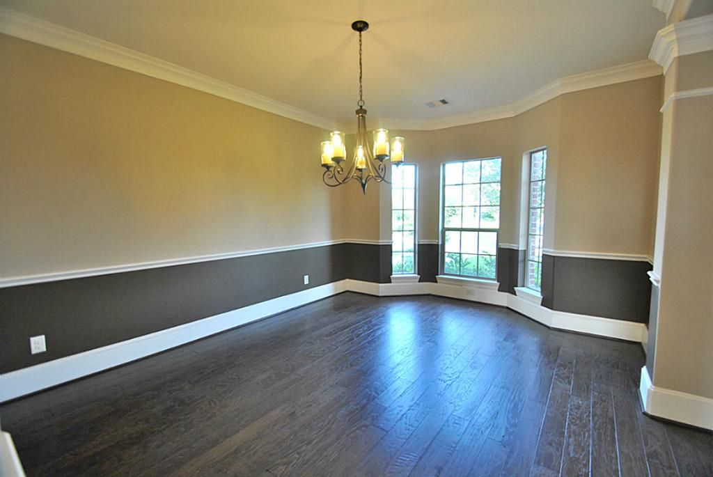 Elegant Formal Dining Room With Upgrade Two Tone Interior Paint, Crown  Molding, Chair Railing