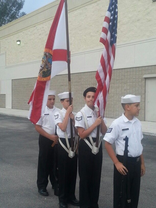 Colour guard at sports authority. (Making faces)